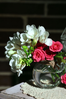 White Freesias and Red Roses in a Vase.