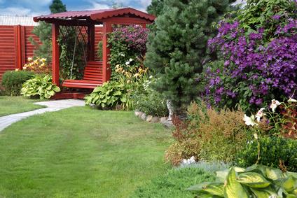 A Charming Wooden Setting In A Perennial Garden.
